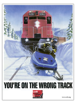 Snowmobile safety poster regarding crossing roads and railroad tracjs