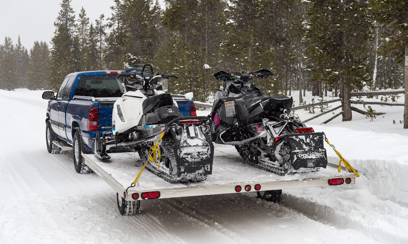 Pickup truck hauling two snowmobiles