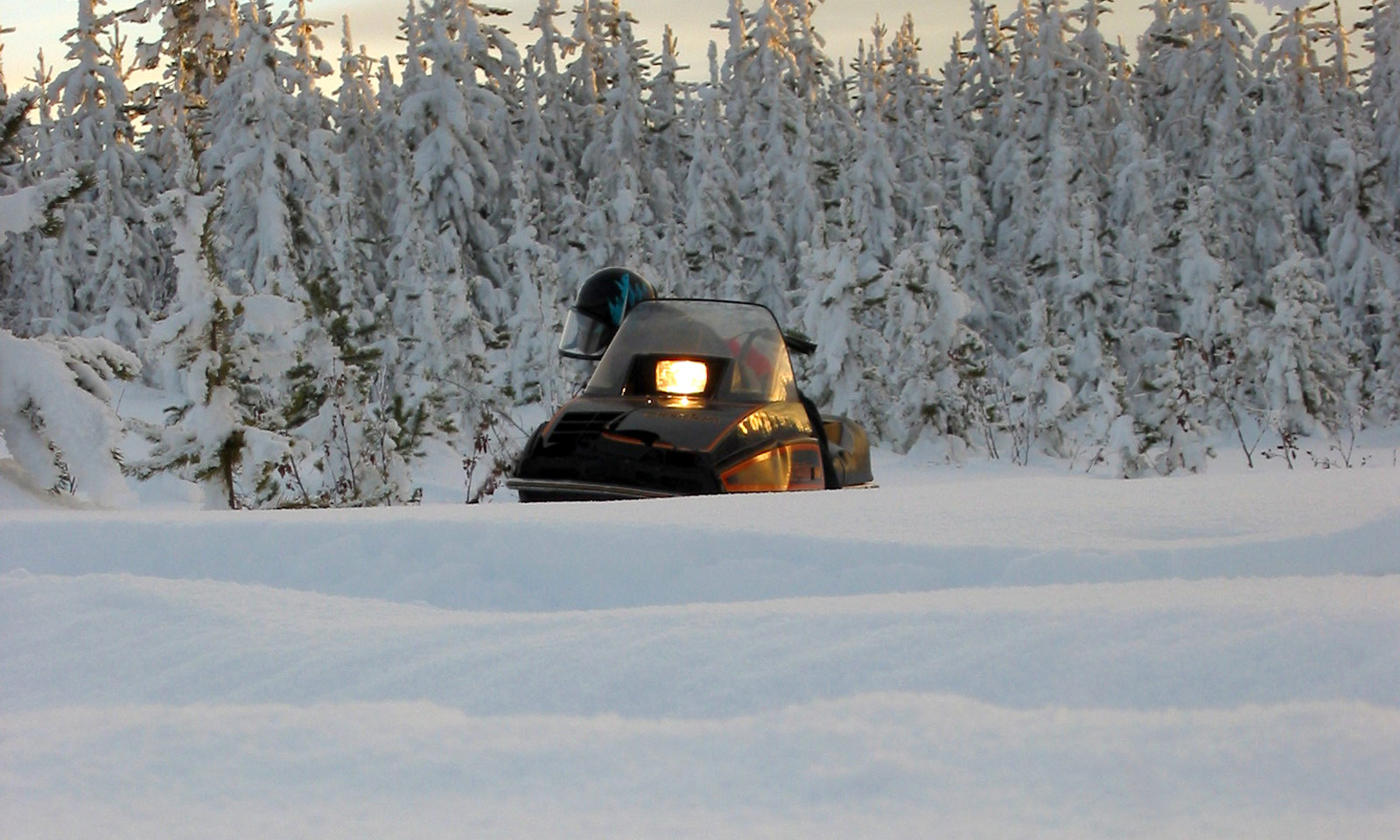 Snowmobile with light on