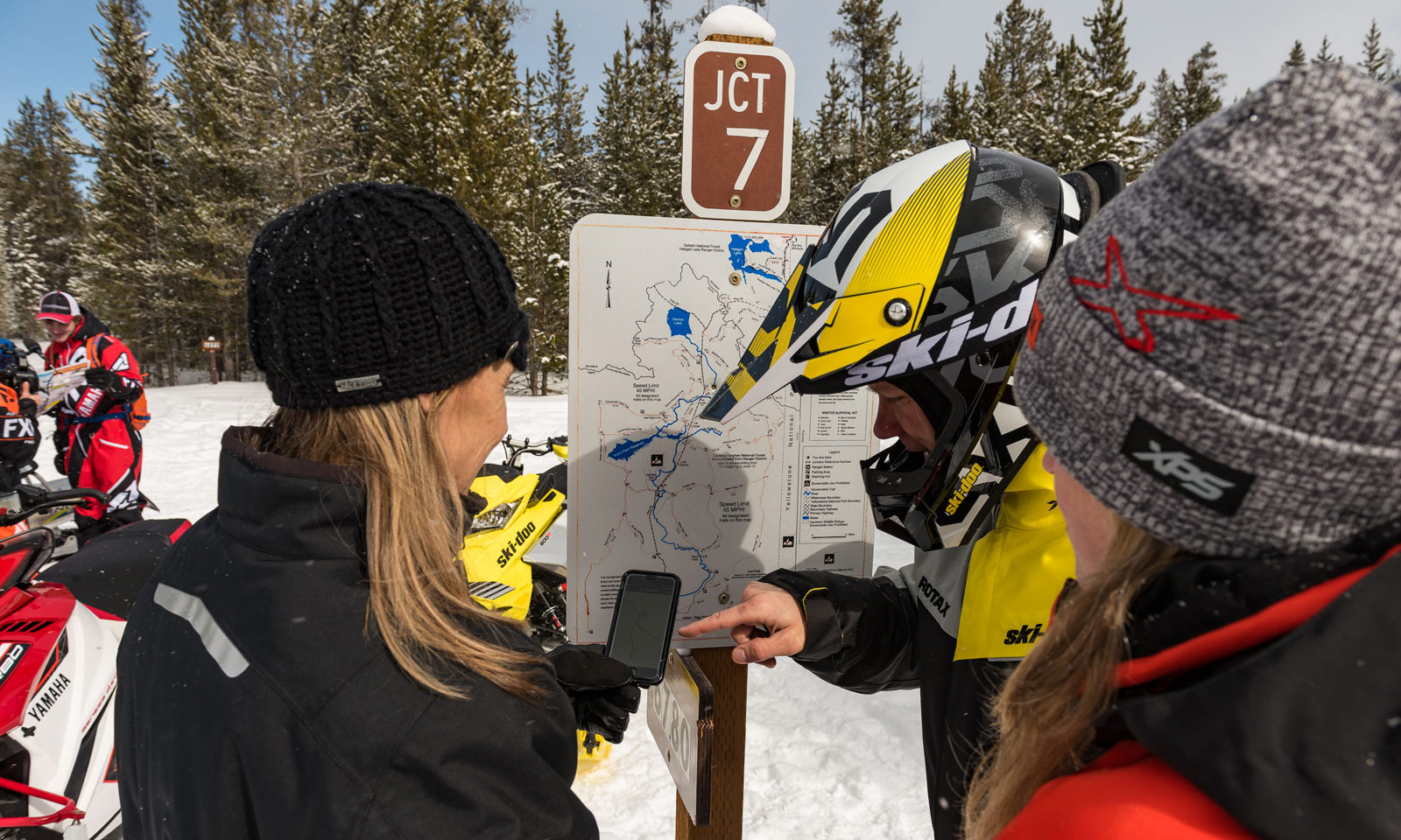 Snowmobilers discussing next trail ride